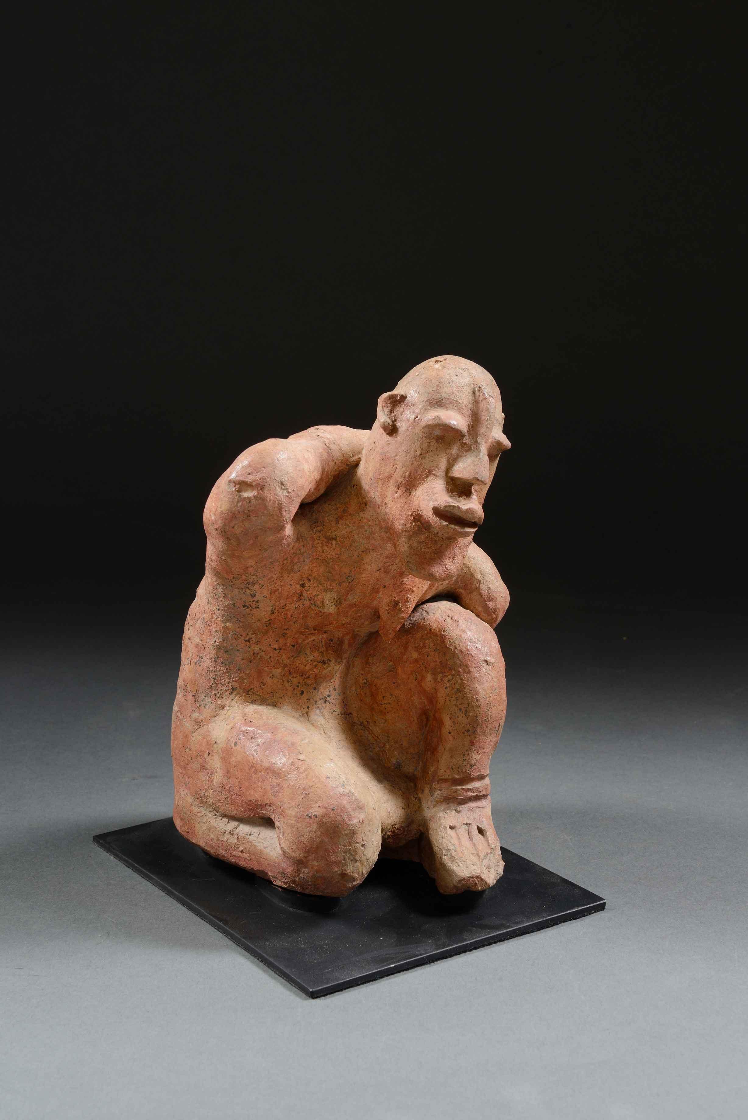 Figura de mujer arodillada - Cultura djenne